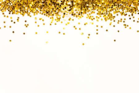 スター形の金色のスパンコールの背景。スペースのコピー。 写真素材