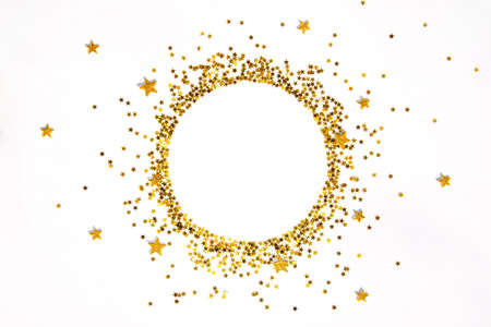 Star shaped golden sequins frame arranged in circle.