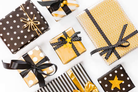 Top view of gift boxes in various black, white and golden designs. Flat lay. A concept of Christmas, New Year, birthday celebration event. Stockfoto