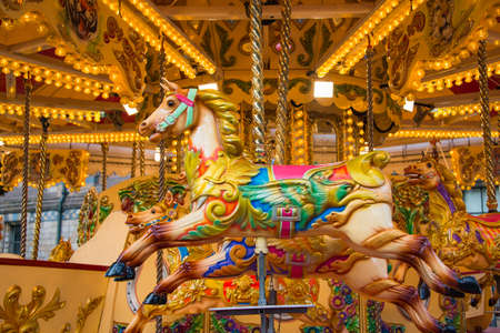Colorful horse carousel at an amusement park.