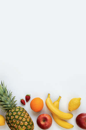 Top view of various fruits on a white background. Copy space. Stockfoto
