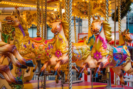 Colorful horse carousel at an amusement park.