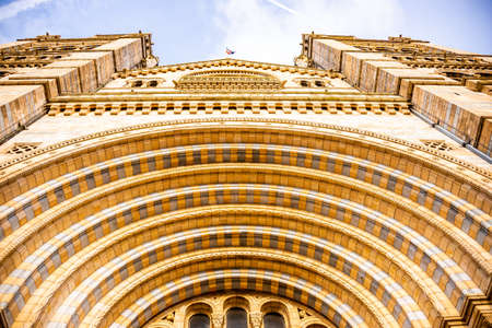 Upwards view of British Natural History Museum entrance in London.