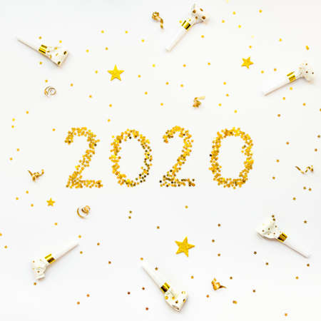 New 2020 Year golden star shaped confetti celebration background.