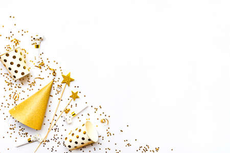 Celebration background - party accessories in golden colors. Copy space.