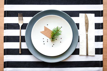Top view of christmas table setting. Festive plate decoration.