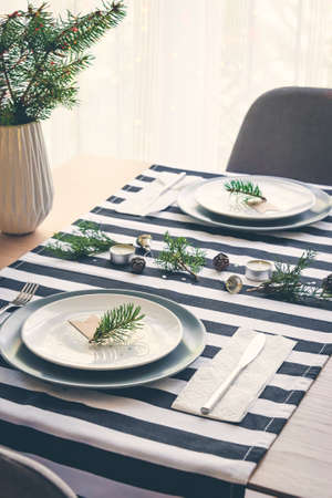 Top view of christmas table setting for two.