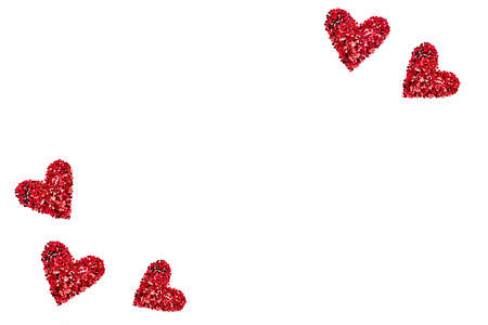 Valentine's Day background - heart shaped confetti arranged like hearts over white background. Zdjęcie Seryjne