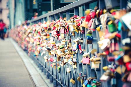 Thousands of love padlocks locked on the rail of Iron Bridge in Frankfurt Um Main.
