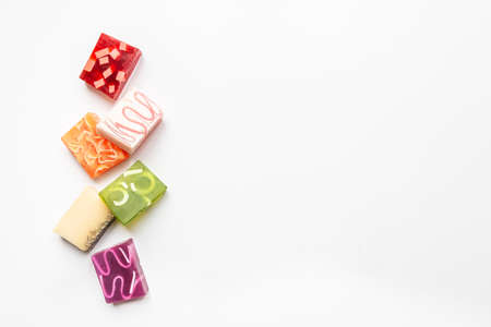 Top view of various colorful handmade soaps. Organic health care and protection. Copy space, white background. 写真素材