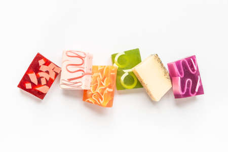 Top view of various colorful handmade soaps. Organic health care and protection.