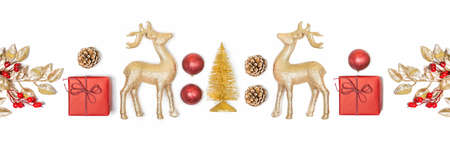Christmas background - gift box, mistletoe, fircones,reindeer and christmas balls in golden and red colors over white background.