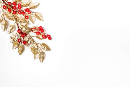 Golden mistletoe leaf over white background. Christmas theme. Copy space.