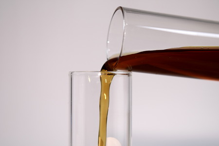 reagent: Pouring reagent into test tube Stock Photo