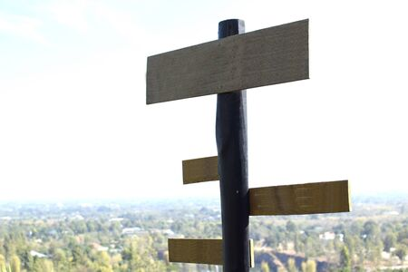 guidepost: Blank wooden multi-direction guidepost Stock Photo