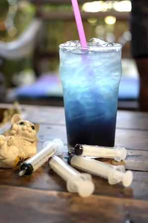 soda splash: Iced blue soda with colorful syringes