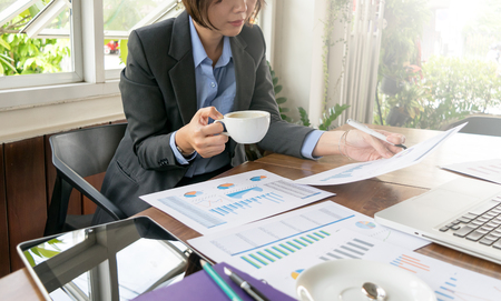 Business woman working for analysis chart and graph with decision making 版權商用圖片