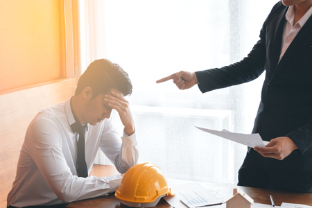 Two engineer or businessman Boss complain the Mistake to another Stock Photo
