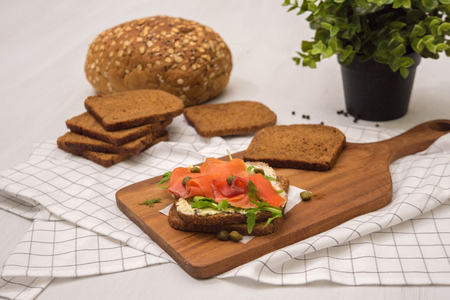 Salmon Sandwich on wooden plate