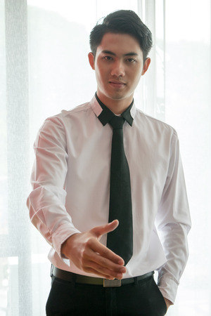 Asian Business Man Hand Shaking with White Background