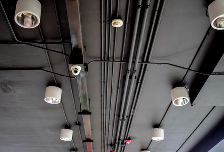 CCTV on ceiling with light and electric tube