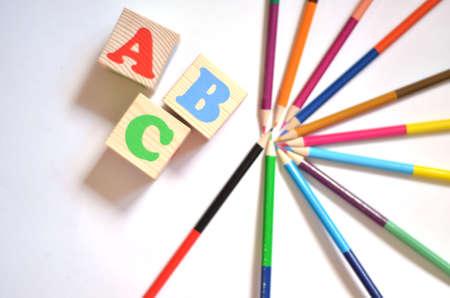 Wood letter blocks alphabet ABC with Wood letter blocks alphabet ABC with colourfull pencils. ABC practice for kids concept. Banque d'images