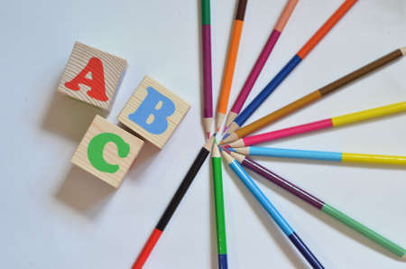 Wood letter blocks alphabet ABC with Multicolored pencils