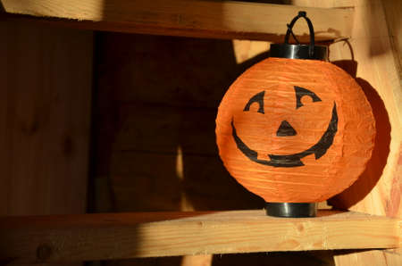 Lantern In The Shape Of A Pumpkin On A Wooden Halloween Staircase, Pumpkins  And Autumn