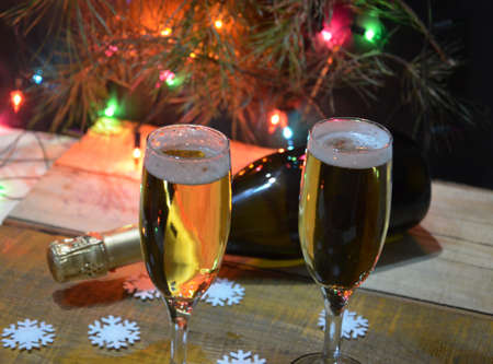 stock photo two glasses of champagne on the background of champagne christmas tree with christmas lights new year and christmas