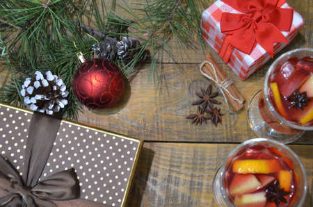 Christmas mulled wine with gift bag with presents red and brown box