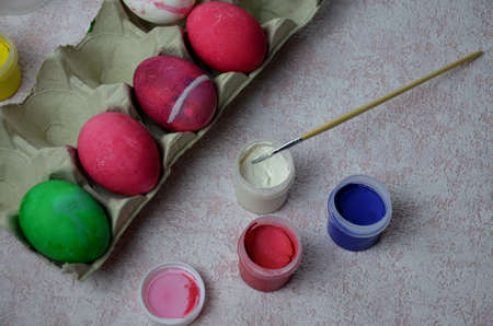 Colorful handmade easter eggs balls with paint and bruch. craft, home made decorations for easter