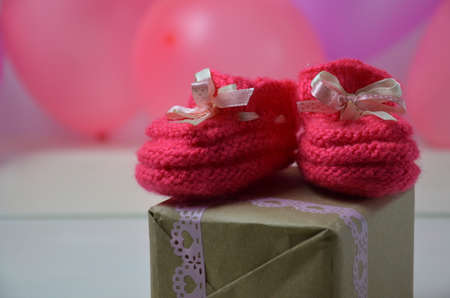Baby girl knitted sandal, booties, shoes baby newborn, blank postcard. cocept it s a girl or baby shower Stock Photo
