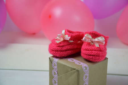 Baby girl knitted sandal, booties, shoes baby newborn, blank postcard. cocept it s a girl or baby shouer Stock Photo