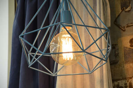 interior of an old retro vintage lamp on a background of gray curtains Archivio Fotografico