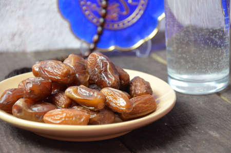A glass of drinking water and date fruits - a food that is consumed before breaking fast during holy month of Ramadan.