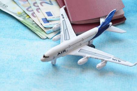 Preparation for Traveling concept, watch, airplane, money, passport, map, phone on sky blue background with copy space. online ticket booking concept