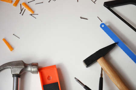 professional builder work with house renovation instruments on white background top view