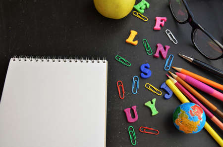 School supplies on blackboard background ready for your design top view copy space. back to school.