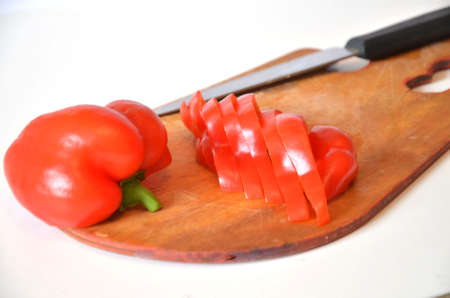 Sliced red sweet pepper on a cutting board