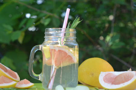 healthy detox smoothie with fresh fruits and green rosemary grapefruit water. Lifestyle detox concept. diet, raw food