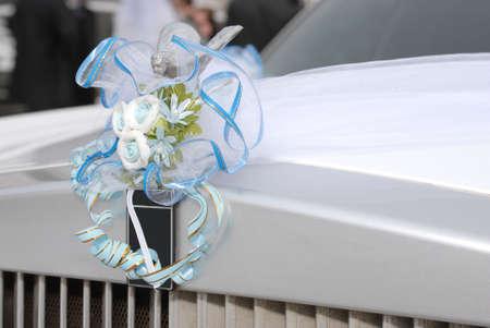 Decoration on the white wedding limousine Stock Photo