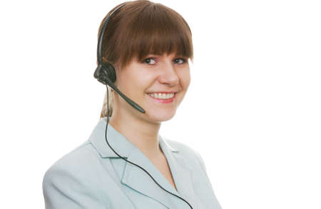 Beautiful customer support agent with headset smiling during a telephone conversation Stock Photo - 2570828