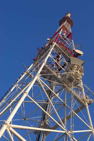 multi antenna communications tower with tv, radio, cellphones, telephones microwave data links etc Stock Photo
