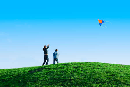 Family playing a kite. Outdoor family weekend