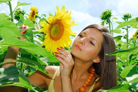 Pretty girl in sunflowers