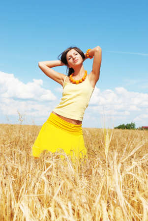 Girl resting on wheat field photo