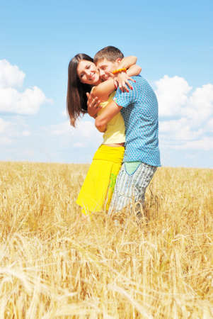 Young couple on wheat field photo
