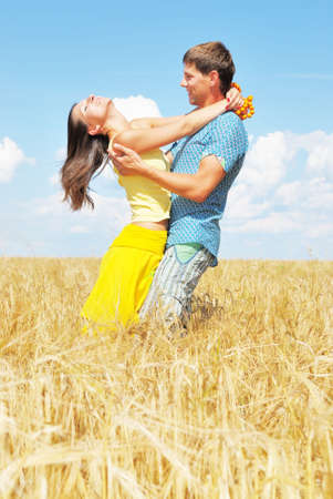 Young couple on wheat field Stock Photo - 5815042