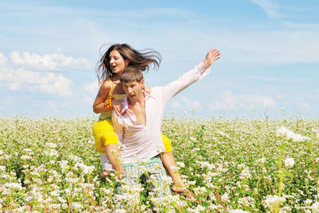 Young couple on field of flowers photo