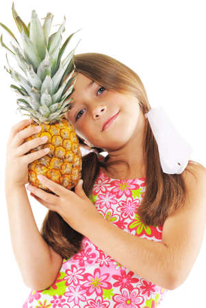 image created 21st century: Little girl posing with big pineapple